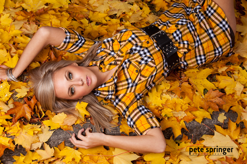 model in autumn leaves